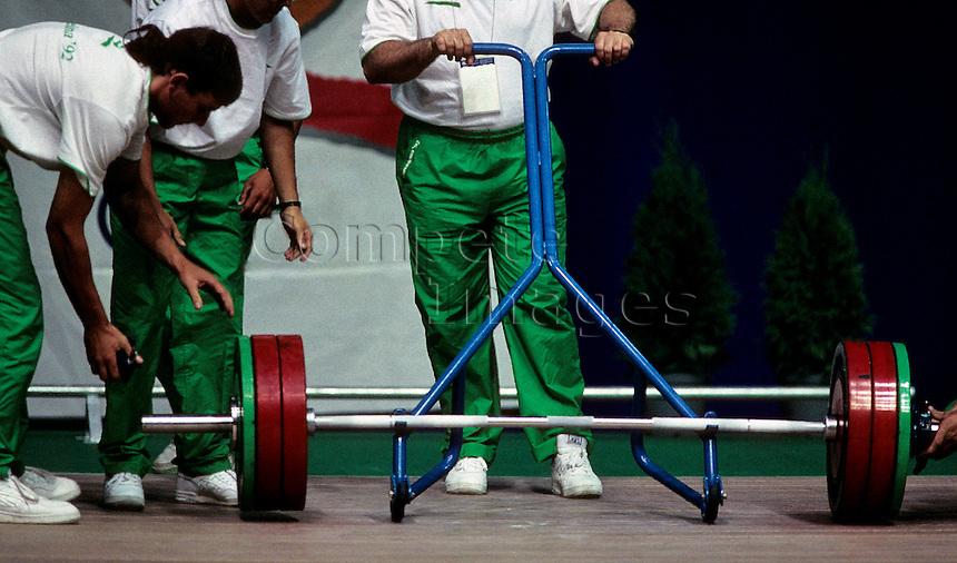 Judges examine weightlifters weight set