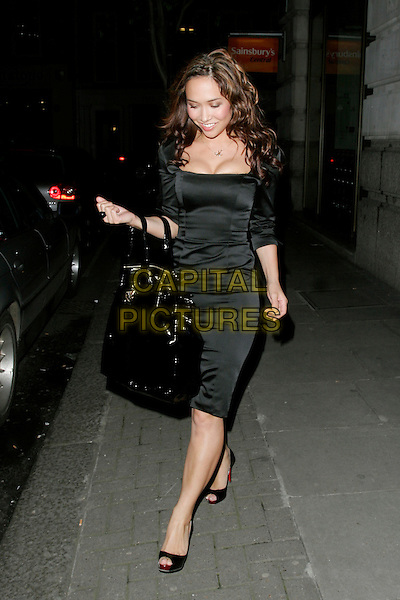 MYLEENE KLASS.Leaving The Classical Brit Awards - launch, Crystal Room, The Mayfair Hotel, London, England..April 8th, 2007.full length black dress cleavage patent large oversized big bag purse open toe shoes walking .CAP/AH.©Adam Houghton/Capital Pictures.