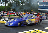 Jun. 2, 2012; Englishtown, NJ, USA: NHRA funny car driver Mike Smith during qualifying for the Supernationals at Raceway Park. Mandatory Credit: Mark J. Rebilas-