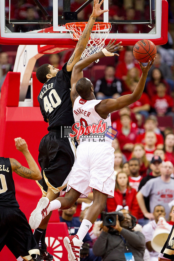 Ty Walker #40 of the Wake Forest Demon Deacons alters the shot of DeShawn Painter #0 of the North Carolina State Wolfpack at the RBC Center on January 8, 2011 in Raleigh, North Carolina.  The Wolfpack defeated the Demon Deacons 90-69.  Photo by Brian Westerholt / Sports On Film