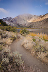 Hiking trail along Convict Lake, with early morning light on Laurel Mountain, fall, Inyo National Forest, California