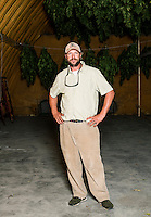 Penn Mattison stands in front of industrial grade hemp hanging to dry after harvest of Charlotte's Web near Wray, Colorado, Monday, September 22, 2014. The Stanley Brothers have developed a popular strain of marijuana that has been found to be helpful in reducing seizures. The marijuana high in CBDs and low in THC, the chemical which gets a person stoned.<br /> <br /> Photo by Matt Nager