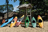 Praia da Concha, Itacare, Bahia State, Brazil. Tourist canoes on the beach.