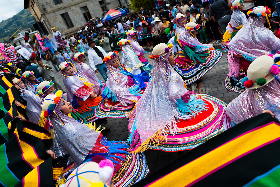 Woman dancers (danzantes) perform in the religious parade within the Corpus Christi festival in Pujilí, Ecuador, 1 June 2013. Every year in June, thousands of people gather in a small town of Pujili, high in the Andes, to celebrate the Catholic feast of Corpus Christi. Introduced originally during the Spanish conquest of South America, this celebration merges Catholic rituals of Holy Communion with the traditional Andean harvest and sun festivities (Inti, the Inca sun god). Women dancers perform wearing brightly colored costumes while men dancers wear chest ornaments and heavy elaborate headdresses adorned with mirrors, jewelry, or natural items (shells). Being a dancer in the Corpus Christi ceremonial parade (El Danzante) is considered an honour and a privilege by the indigenous people in Ecuador.