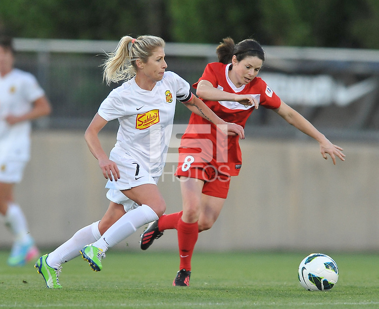 Alex Sahlen (2) of the Western New York Flash goes against Diana Matheson (8) of the Washington Spirit. The Washington Spirit tied The Western New York 1-1 in the home opener of The National Women's Soccer League, at Maryland SoccerPlex, Saturday April 20, 2013.