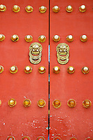 Heavy ornate door knockers on a gate, Temple of Heaven, Beijing, China.