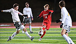 Kirkwood forward Owen Hardy sends the ball between two CBC players. CBC played Kirkwood in a Class 4 sectional soccer game at Kirkwood High School in Kirkwood on Thursday November 14, 2019.<br /> Tim Vizer/Special to STLhighschoolsports.com