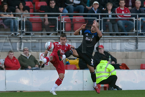 15.10.2011, London, England. Dean Cox Orient's midfielder and Phil Picken Bury's defender  in action during the NPower league one football match between Leyton Orient and Bury played at the Matchroom Stadium, Brisbane Road, London. Mandatory credit: ActionPlus