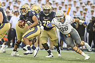 Annapolis, MD - September 8, 2018: Navy Midshipmen quarterback Malcolm Perry (10) avoids Memphis Tigers defensive lineman Jonathan Wilson (38) tackle during the game between Memphis and Navy at  Navy-Marine Corps Memorial Stadium in Annapolis, MD.   (Photo by Elliott Brown/Media Images International)