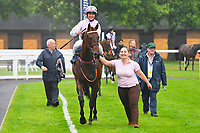 Winner of The Shadwell Racing Excellence Apprentice Handicap Div 2  Bounty Pursuit ridden by Marco Ghiani and trained by Michael Blake  is led into the Winner's enclosure during Horse Racing at Salisbury Racecourse on 14th August 2019