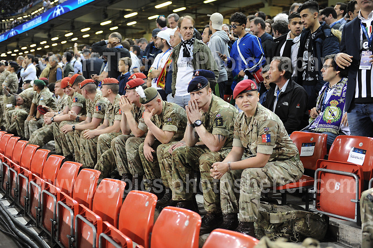 Members of the army prepare to carry out their field duties before the game. <br /> <br /> <br /> Jeff Thomas Photography<br /> www.jaypics.photoshelter.com<br /> e-mail swansea1001@hotmail.co.uk<br /> Mob: 07837 386244<br /> <br /> Supporters of Juventus and Real Madrid enjoying the atmosphere at the National Stadium of Wales before the UEFA Champions League Final on Saturday 3rd June 2017
