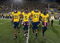 California captains' Keenan Allen, Michael Lowe, Brian Schwenke and Josh Hill walk on the field for coin toss during coin toss ceremony before the game against UCLA at Memorial Stadium in Berkeley, California on October 6th, 2012.  California defeated UCLA, 43-17.