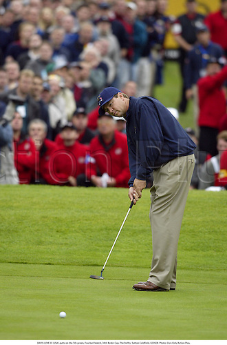 DAVIS LOVE III (USA) putts on the 5th green, Fourball Match, 34th Ryder Cup, The Belfry, Sutton Coldfield, 020928. Photo: Glyn Kirk/Action Plus....2002.putts putting.golf golfers player