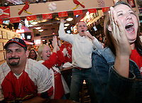 From left, Walter Staas, of South City, Abbey Bates, of Edwardsville, Aaron Bass, of Edwardsville, and Wendy Sutter, of South City, cheer at Al Hrabosky's Sports Saloon as the Cardinals score two runs in the ninth inning of game 7 of the National League Championship Series against the New York Mets. The St. Louis Cardinals lost the game 4-2 on Wednesday, October 18, 2006.