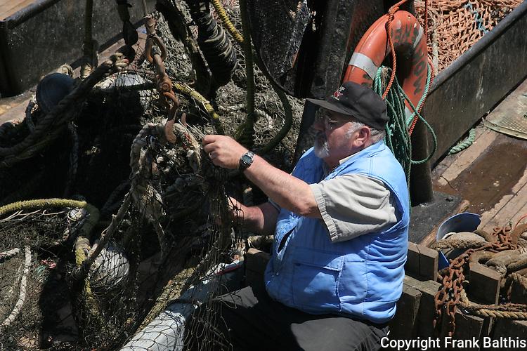 Fisherman working on nets in Monterey