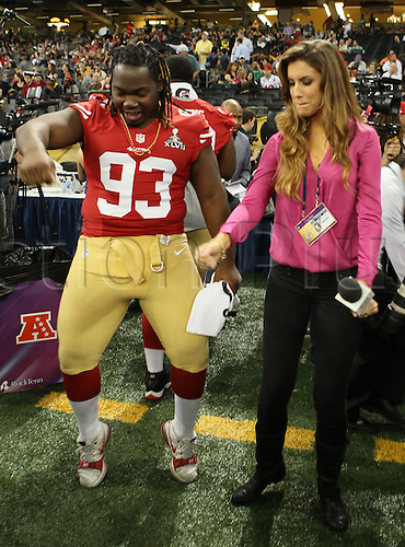 29.01.2013. New Orleans, USA.  San Francisco 49ers nose tackle Ian Williams (93) is interviewed by Inside Edition reporter Katherine Webb during 49ers Media Day at Mercedes-Benz Superdome in New Orleans, LA.