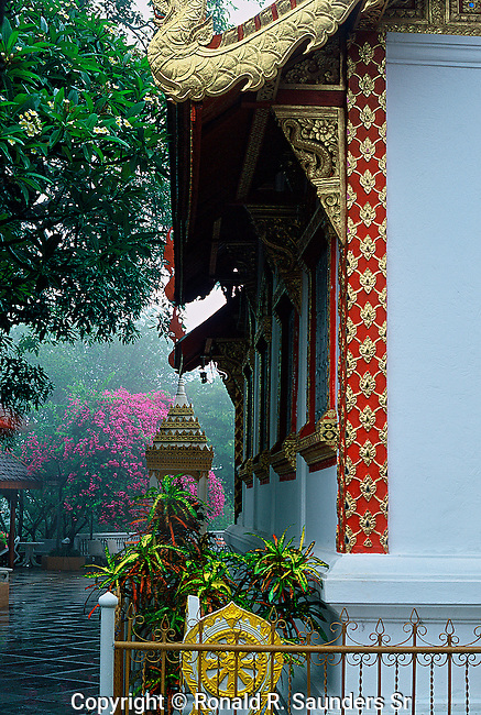 """Wat Phra That Doi Suthep (Thai: วัดพระธาตุดอยสุเทพ, Thai pronunciation: [wát.pʰráʔ.tʰâat.dɔɔj.sùʔ.tʰêep], Northern Thai pronunciation: [wa̋t.pʰa̋ʔ.tʰâat.dɔɔj.súʔ.têep]) is a Theravada Buddhist temple in Chiang Mai Province, Thailand. The temple is often referred to as """"Doi Suthep"""" although this is actually the name of the mountain it is located on. The temple is located 15 kilometres (9.3 mi) from the city of Chiang Mai and is a sacred site to many Thai people. From the temple, impressive views of Chiang Mai can be seen and it remains a popular destination for tourists."""