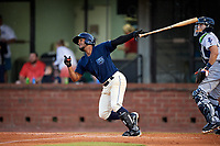 Mobile BayBears shortstop Alberto Triunfel (2) follows through on a swing in front of catcher Adrian Nieto (17) during a game against the Pensacola Blue Wahoos on April 25, 2017 at Hank Aaron Stadium in Mobile, Alabama.  Mobile defeated Pensacola 3-0.  (Mike Janes/Four Seam Images)