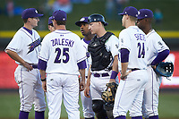 Winston-Salem Dash pitching coach Matt Zaleski (25) has a meeting on the mound with starting pitcher Jimmy Lambert (left) and the entire infield during the game against the Salem Red Sox at BB&T Ballpark on April 20, 2018 in Winston-Salem, North Carolina.  The Red Sox defeated the Dash 10-3.  (Brian Westerholt/Four Seam Images)