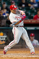 Philadelphia Phillies catcher Carlos Ruiz #51 swings during the Major League baseball game against the Houston Astros on September 16th, 2012 at Minute Maid Park in Houston, Texas. The Astros defeated the Phillies 7-6. (Andrew Woolley/Four Seam Images).