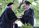 Daniel Wilson receives his degree from President Mark Ghan during the 2018 Western Nevada College Commencement ceremony, in Carson City, Nev., on Monday, May 21, 2018. <br /> Photo by Cathleen Allison/Nevada Momentum