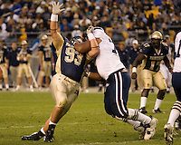 Virginia Cavaliers center Ian-Yates Cunningham roughs up Pitt defensive lineman Gus Mustakas (93). The Pitt Panthers defeated the Virginia Cavaliers 38-13 on September 02, 2006 at Heinz Field, Pittsburgh, Pennsylvania.