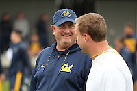 SYDNEY, AUSTRALIA - August 22, 2016:  Cal Bears Football team Australia trip.  Sonny Dykes talks with Jake Spavital at practice.