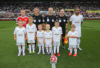 Pictured: Chldren mascots with Manchester United captain Wayne Rooney, referee Martin Atkinson and Swansea captain Ashley Williams Sunday 30 August 2015<br />