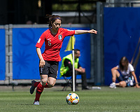 GRENOBLE, FRANCE - JUNE 12: Doyeon Kim #5 of the Korean National Team passes the ball during a game between Korea Republic and Nigeria at Stade des Alpes on June 12, 2019 in Grenoble, France.