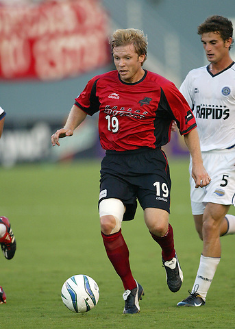 DALLAS, TX AUGUST 7:  Bobby Rhine #19 of the Dallas Burn in action against Colorado Rapids at Cotton Bowl in Dallas, Texas on August 7, 2004. (Photo by Rick Yeatts) Rhine's career consisted of 212 games making 136 starts, played more than 12,000 minutes scoring 23 goals and 34 recorded assists.