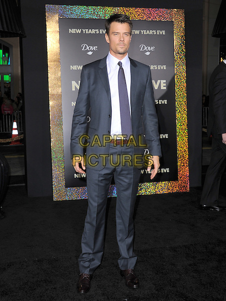 "Josh Duhamel.The World Premiere of ""New Year's Eve' held at The Grauman's Chinese Theatre in Hollywood, California, USA..December 5th, 2011.full length suit grey gray tie purple black white shirt  .CAP/RKE/DVS.©DVS/RockinExposures/Capital Pictures."