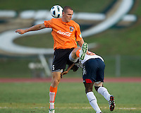 Jo Conner of the Charlotte Eagles is disrupted by Mustapha Riga of the Bolton Wanderers.  The Charlotte Eagles currently in 3rd place in the USL second division play a friendly against the Bolton Wanderers from the English Premier League.