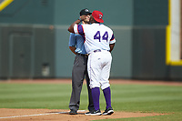 Winston-Salem Rayados hitting coach Charlie Poe (44) gets in the face of umpire Jason Johnson after have been ejected from the game against the Potomac Nationals at BB&T Ballpark on August 12, 2018 in Winston-Salem, North Carolina. The Rayados defeated the Nationals 6-3. (Brian Westerholt/Four Seam Images)