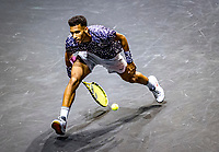 Rotterdam, The Netherlands, 14 Februari 2020, ABNAMRO World Tennis Tournament, Ahoy,  Felix Auger-Aliassime (CAN) hits a tweener<br /> Photo: www.tennisimages.com