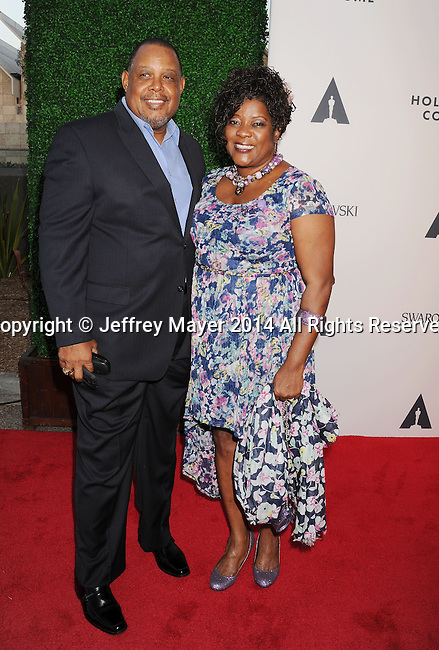 LOS ANGELES, CA- OCTOBER 01: Actress Loretta Devine (R) and Glenn Marshall attend The Academy of Motion Picture Arts and Sciences' Hollywood Costume Opening Party at the Wilshire May Company Building on October 1, 2014 in Los Angeles, California.