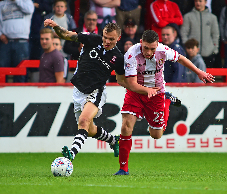 Lincoln City's Harry Anderson vies for possession with Stevenage's Kevin Toner<br /> <br /> Photographer Andrew Vaughan/CameraSport<br /> <br /> The EFL Sky Bet League Two - Stevenage v Lincoln City - Saturday 9th September 2017 - The Lamex Stadium - Stevenage<br /> <br /> World Copyright &copy; 2017 CameraSport. All rights reserved. 43 Linden Ave. Countesthorpe. Leicester. England. LE8 5PG - Tel: +44 (0) 116 277 4147 - admin@camerasport.com - www.camerasport.com