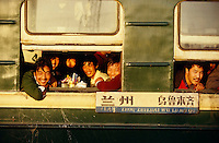 Passengers of the Lanzhou-Urumqi-Express smiling friendly and curiously at passengers of Marco Polo Express during a stopover at Jiayuguan.