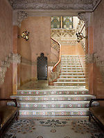 The magnificent entrance hall has a mosaic-tiled floor and a marble staircase decorated with flowers