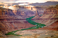 Spring runoff greens valley along desert river