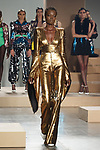 Model walks runway in a gold sequin BOGDAN jumpsuit with angel style sleeves from the Greta Constantine Spring Summer 2018 collection by Kirk Pickersgill and Stephen Wong on September 6, 2017; at Pier 59 Studios during New York Fashion Week.