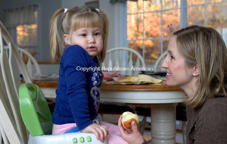 OXFORD, CT. 28 October 2011-102281SV03--Kendall Blair, 2, eats breakfast with her mom, Lauren Blair, while getting ready for daycare in Oxford Friday. A recent study showed that sending a young child to full time day care costs the same as one year of tuition and fees at a public university.<br /> Steven Valenti Republican-American