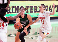 COLLEGE PARK, MD - DECEMBER 8: Stephanie Karcz #10 of Loyola sends a pass way from Faith Masonius #13 of Maryland during a game between Loyola University and University of Maryland at Xfinity Center on December 8, 2019 in College Park, Maryland.