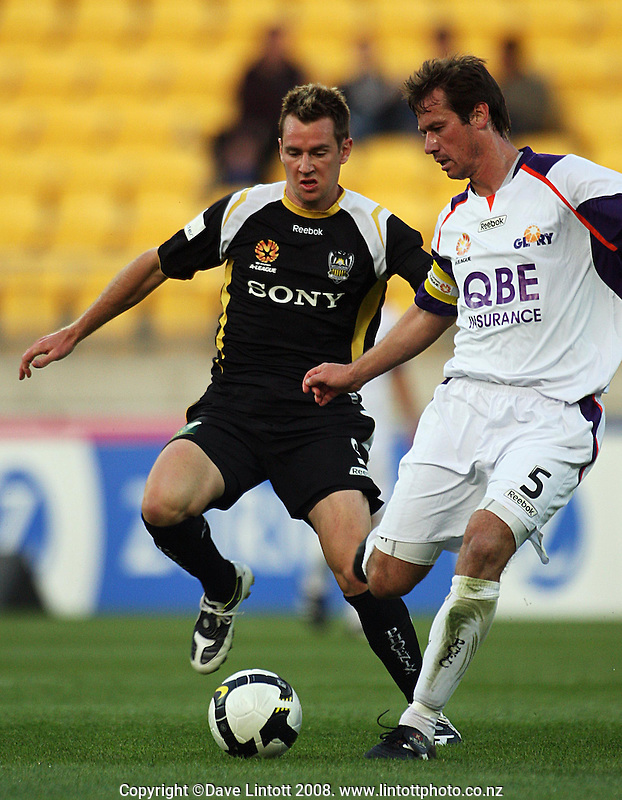 Shane Smeltz pressures Jamie Harnwell during the A-League football match between the Wellington Phoenix and Perth Glory at Westpac Stadium, Wellington, New Zealand on Saturday, 13 December 2008. Photo: Dave Lintott / lintottphoto.co.nz