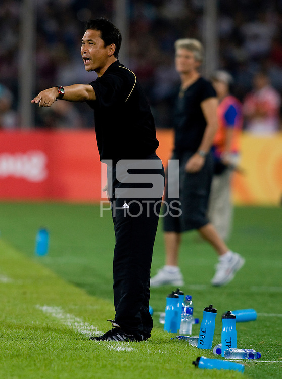 Japanese head coach Norio Sasaki yells to his team while playing at Worker's Stadium.  The USWNT defeated Japan, 4-2, during the semi-finals of the Beijing 2008 Olympics in Beijing, China.
