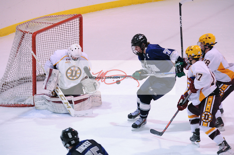 Eagle River's Sutton McDonald gets a shot off against Blue Hildebrand during the Wolves' 4-2,  first-ever win over Dimond at Ben Boeke Arena Saturday, November 19, 2016.  Photo for the Star by Michael Dinneen