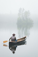 &quot;Spring Serenity&quot;<br /> <br /> The canoeist paddles through the serenity and mystery of the saturated spring landscape. A symphony of birdsong penetrates the thick blanket of fog. These life-enriching experiences with nature nourish and heal the mind, body, and soul.