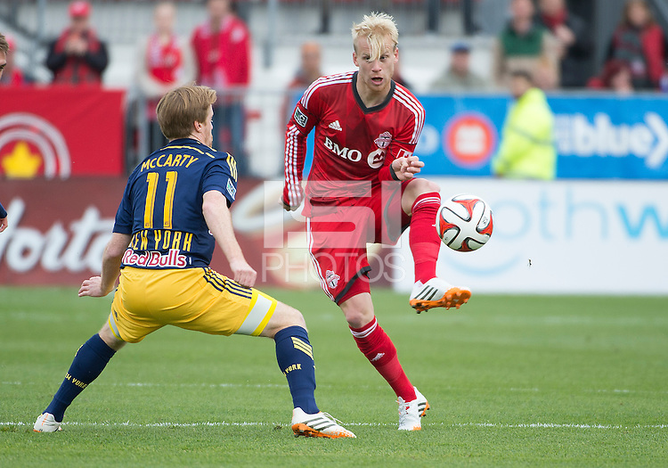 Toronto, Ontario - May 17, 2014:Toronto FC midfielder Kyle Bekker #8 and New York Red Bulls midfielder Dax McCarty #11 in action during a game between the New York Red Bulls and Toronto FC at BMO Field. Toronto FC won 2-0.