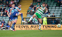 Paul Hayes of Wycombe Wanderers shoots under pressure from Alex Lawless of Yeovil Town during the Sky Bet League 2 match between Yeovil Town and Wycombe Wanderers at Huish Park, Yeovil, England on 8 October 2016. Photo by Mark  Hawkins / PRiME Media Images.