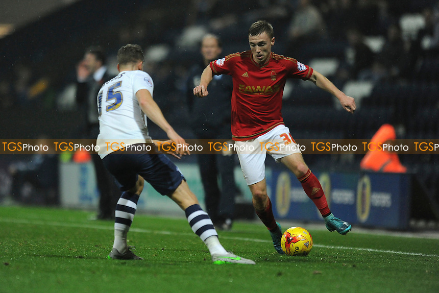 Ben Osborn of Nottingham Forest looks to get past Calum Woods of Preston North End during Preston North End vs Nottingham Forest, Sky Bet Championship Football at Deepdale, Preston, England on 03/11/2015