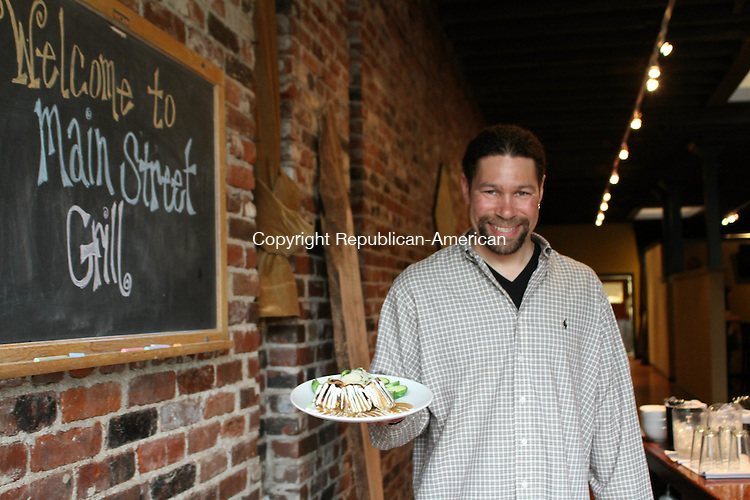 WATERTOWN, CT-15 May 2012-051512LW05- John Bordeaux, owner of the recently-opened Main Street Grill, shows off one of his dishes. Laraine Weschler Republican-American
